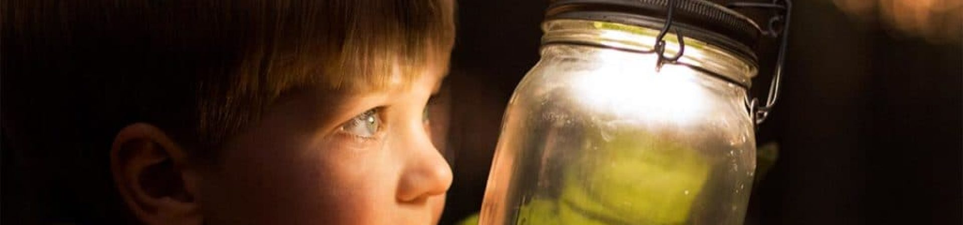 Child Looking at Fireflies in a Jar Kinderfli Ignite Book about Parenting Neurodiverse Children